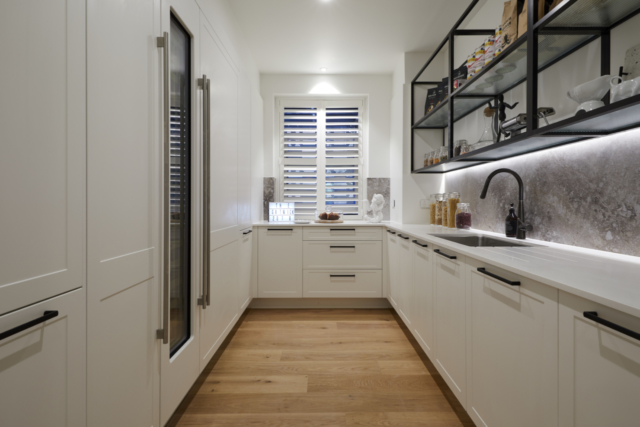 There are large Subzero fridges to the left (behind cabinet doors). In what looks like a small kitchen. Except it's not a kitchen, it's a butlers pantry. | from TV show The Block |  source