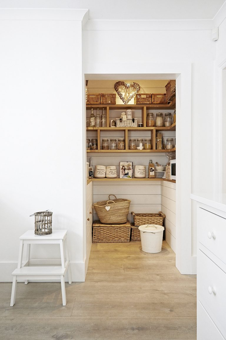 Crisp white shiplap walls, styled with wicker baskets and timber shelves. Perfect. It would be a shame to close this off with a door. | location agency:  Shootfactory