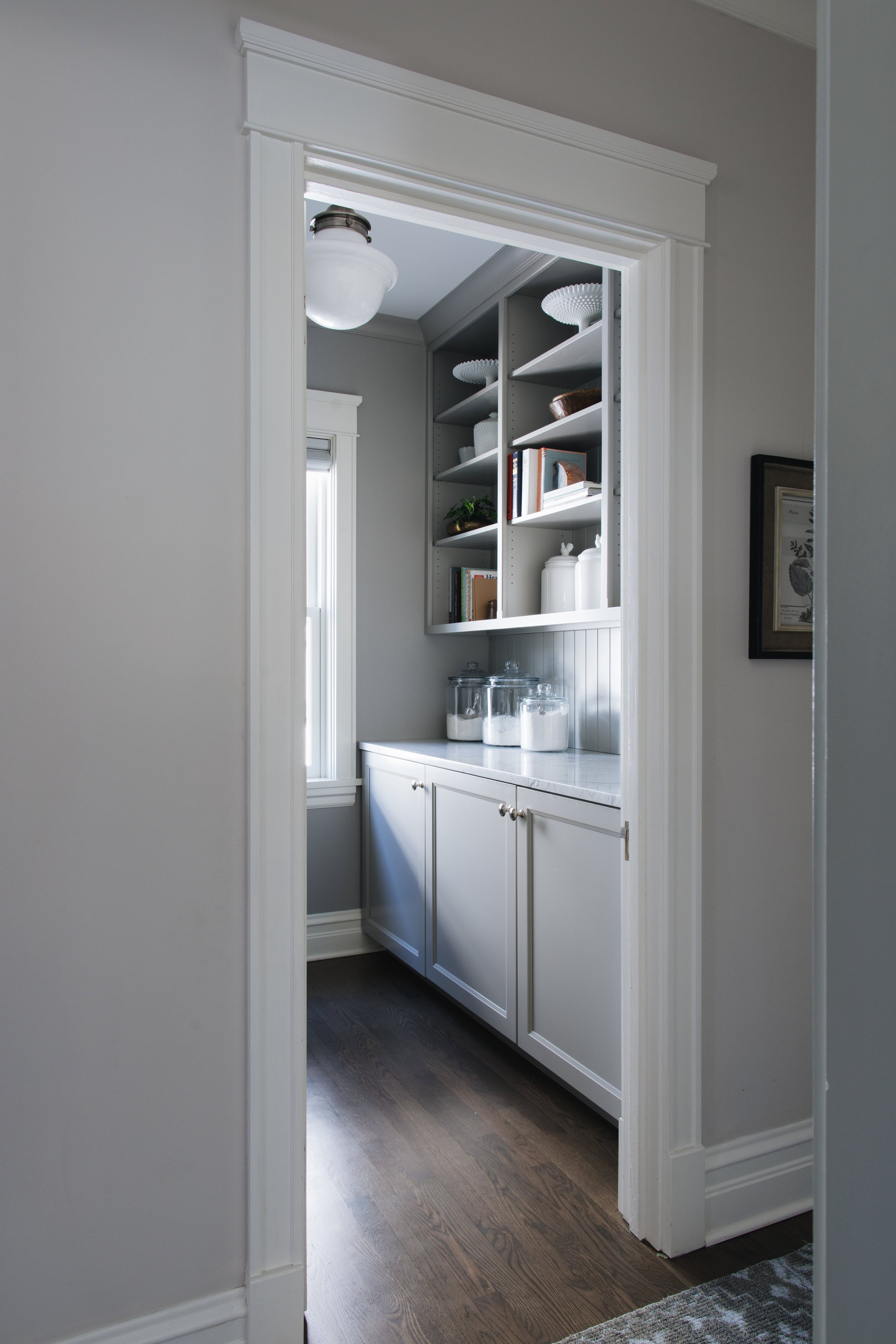 This butlers pantry probably has a door but it could very well succeed without one. Looking in, everything is arranged perfectly and there's cupboards below bench. | designed by:  Jean Stoffer Design
