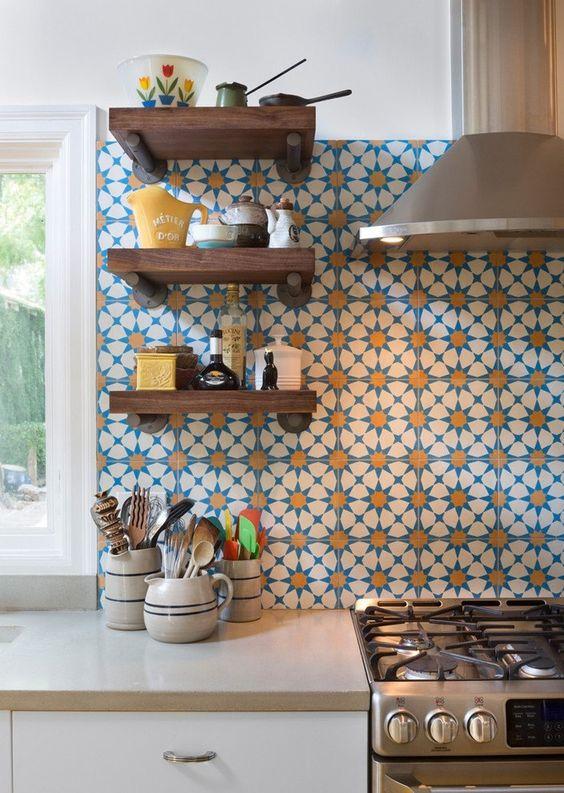 Mediterranean encaustic cement tiles featuring a happy sunburst pattern. The 8 point star motif is often found in traditional Moorish tiles. Kitchen designed by  Hello Kitchen