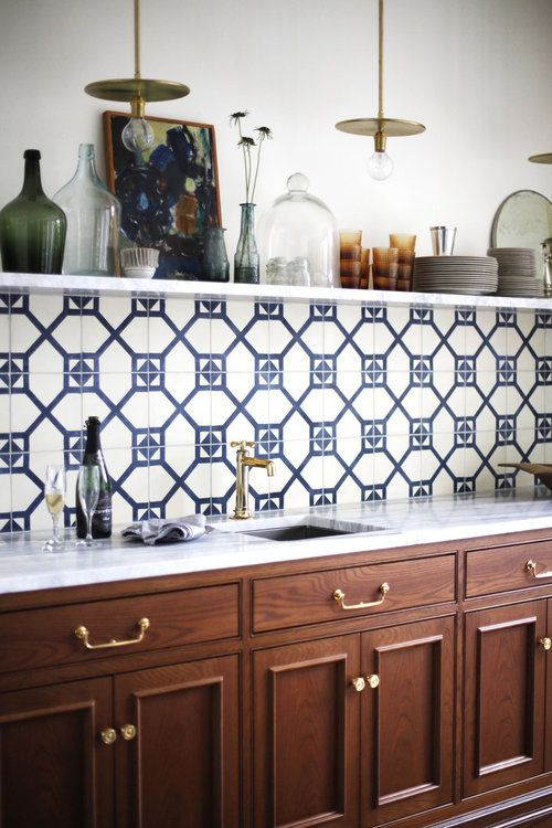 Geometric patterned, navy and white tiles. The mix of modern and traditional is very well done in this drinks / sideboard area. Interior designer:  Katie Hackworth