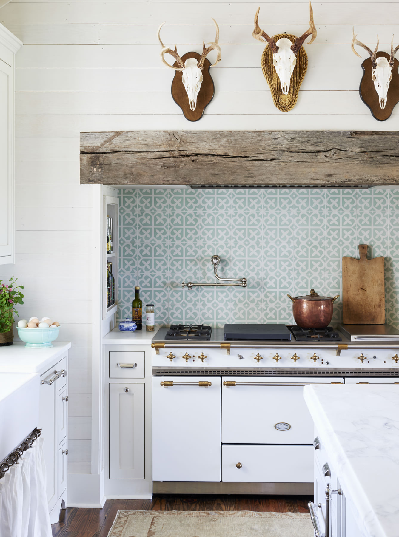 Farmhouse kitchen with a California cool vibe. Using minty, Spanish inspired cement tiles behind the stove. Interior designer:  Ashley Gilbreath