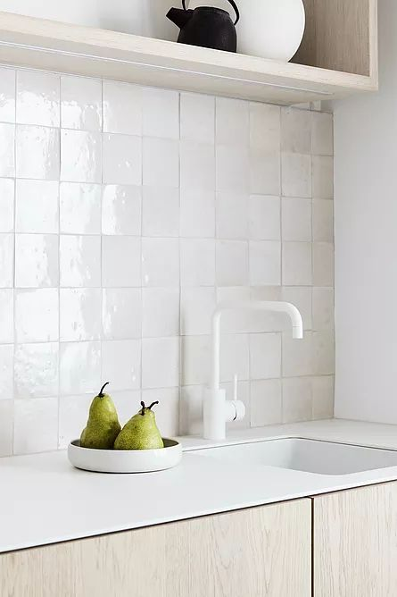 The handmade white Zellige tiles add texture to a mostly white scheme. Interior design:  Carole Whiting