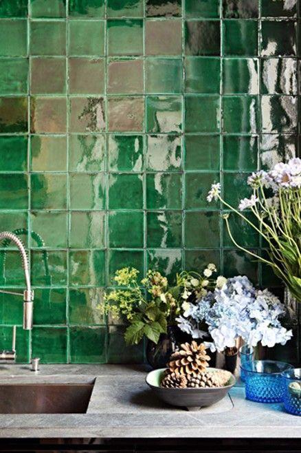 Dramatic green Zellige tiles feature in this Parisian kitchen. Interior Design:  Studio Ko
