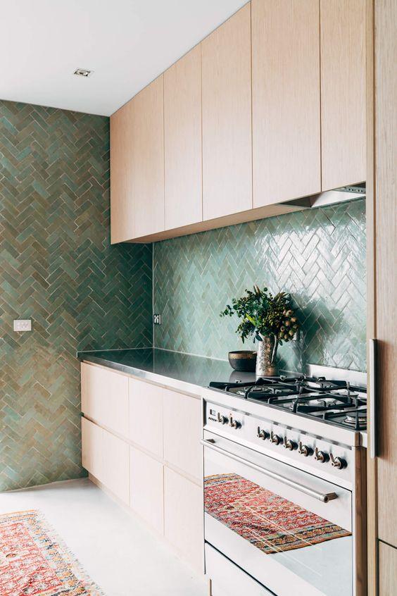 Green Zellige Moroccan tiles in a herringbone pattern. Striking. Interior designer and tile supplier:  Georgia Ezra
