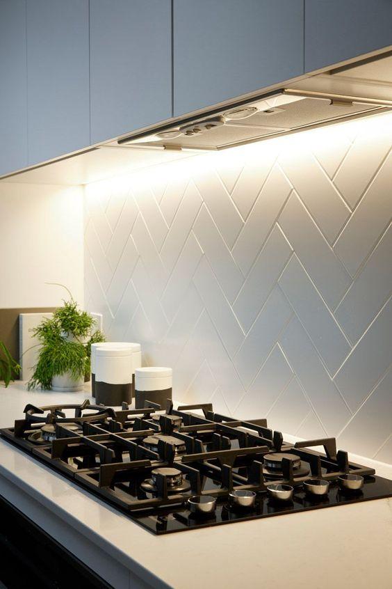 Matte white herringbone splashback in a modern kitchen my  Freedom Kitchens , as seen on TV show Reno Rumble
