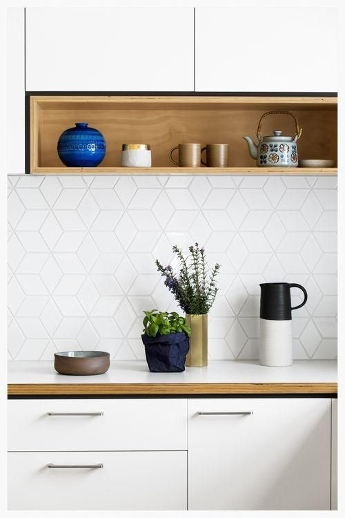 3D cube geometric tiles in white. Kitchen designed and made by  Cantilever Interiors