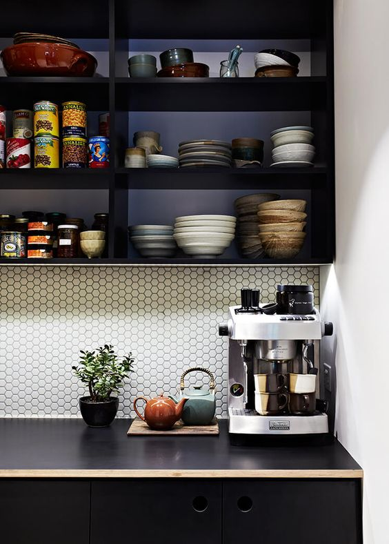 Tiny white hexagon tiles creating subtle geometric details in this butlers pantry. Interior design:  Doherty Design Studio