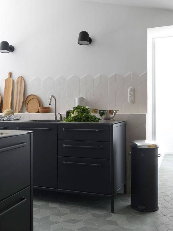I love the edge detail on this splashback, using unfinished 3D cube shaped tiles. French farmhouse kitchen with black steel cabinets from  Vipp