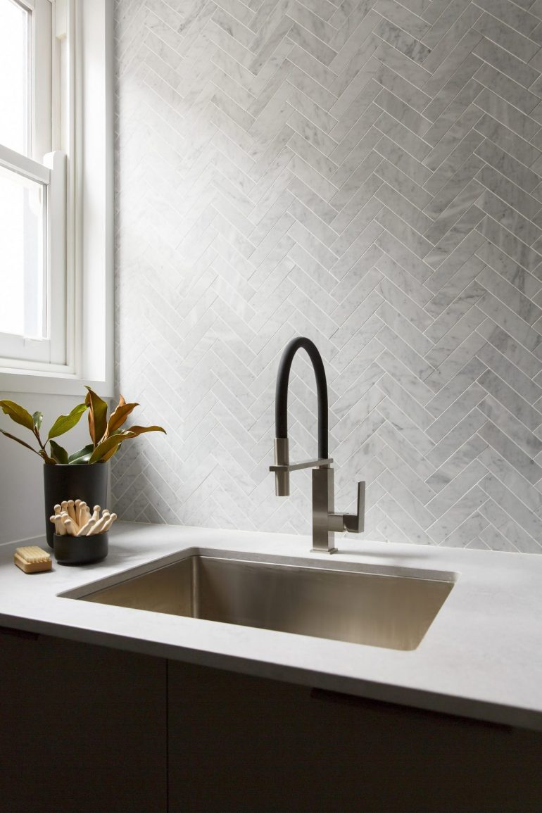 Stunning marble herringbone tiles in this laundry. Designed by Kerrie & Spence, channel 9's The Block. Image source:  getinmyhome.com