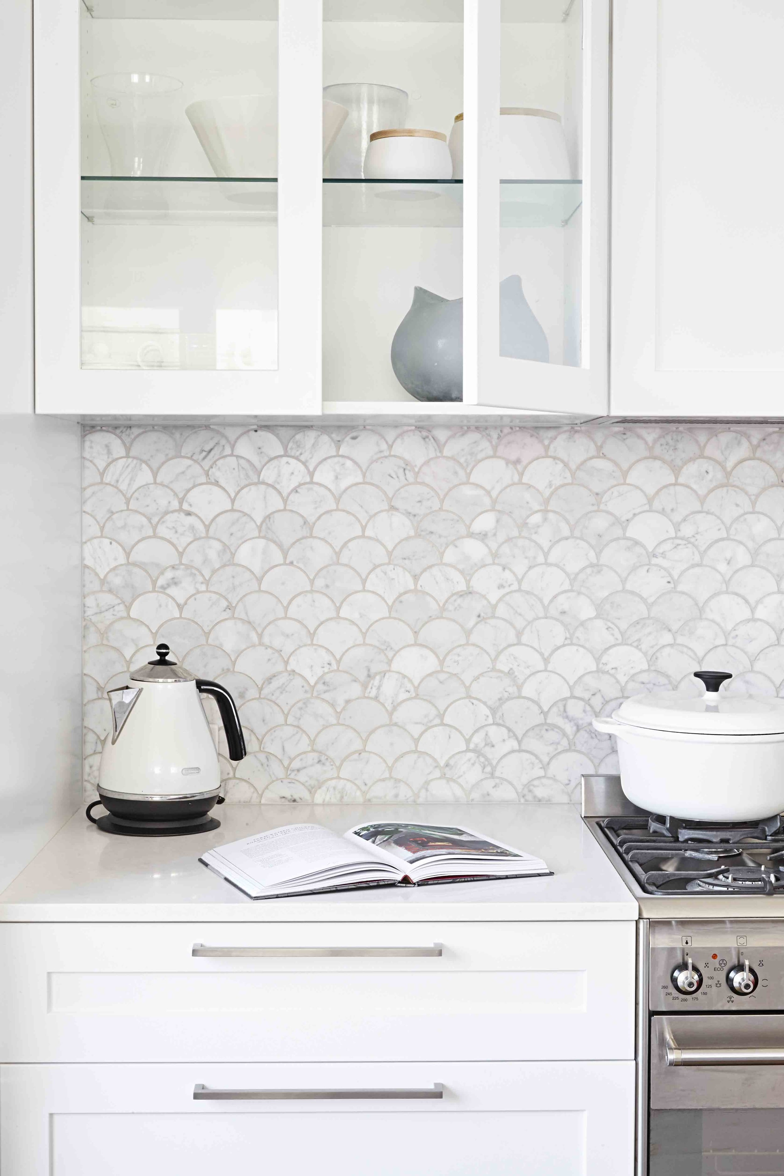 Moroccan fish scale tiles in carrara marble. Beautiful (and looks very expensive). Interior Architecture:  Sally Rhys-Jones