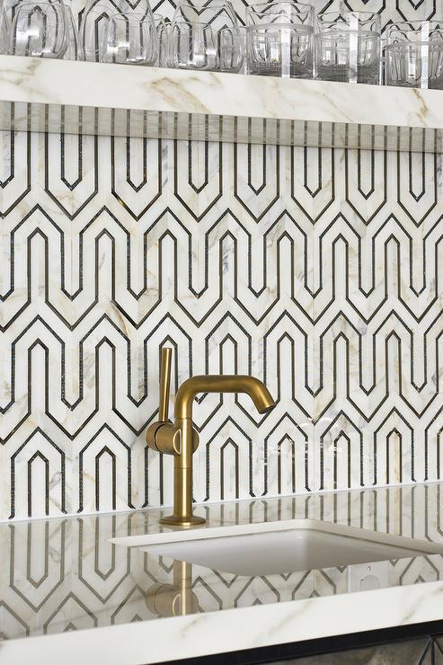 Geometric marble and metallic splashback. Photography:  Stephani Buchman