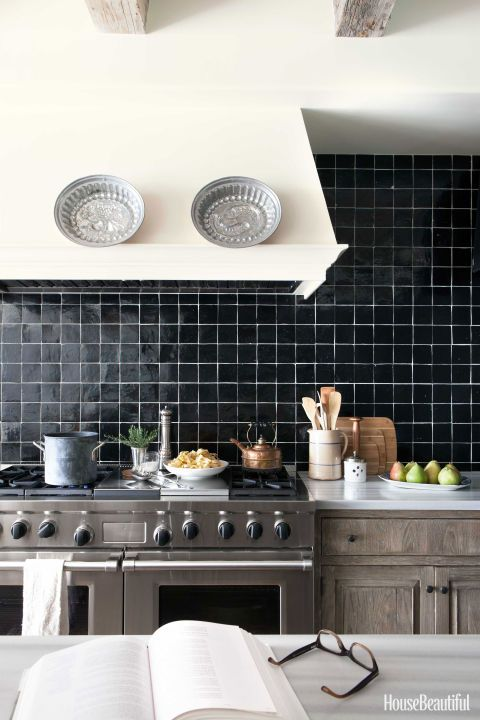 Timeless Los Angeles kitchen with black Zellige tiles and white grout for a graphic look. Interior Design:  Chris Barrett