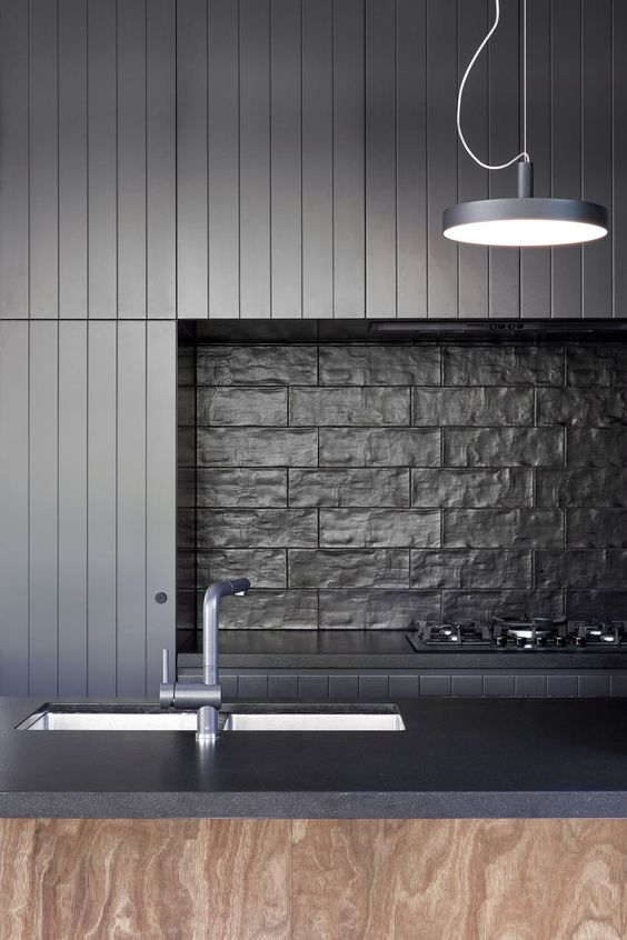 An all black colour scheme really benefits from texture in the tiles. Architects:  Splinter Society