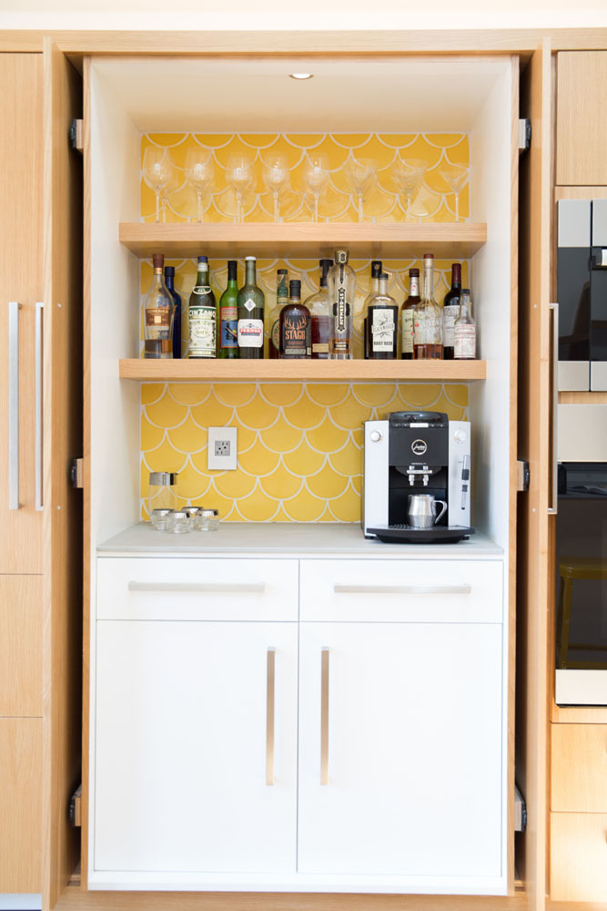 Yellow fish scale tiles in this fun, drinks pantry. The fold away pocket doors are great idea too.  Amy Sklar Design