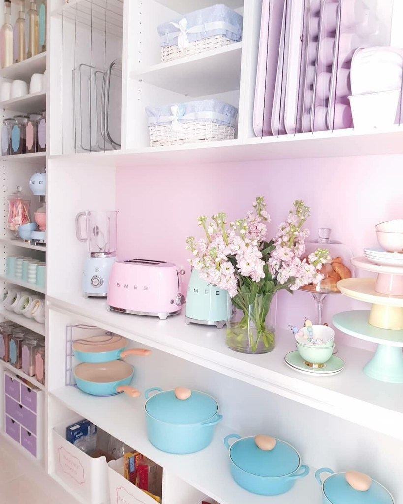 Soft pastel pink complementing everything well in this adorable pantry. Does it make you feel like baking?  From Great Beginnings