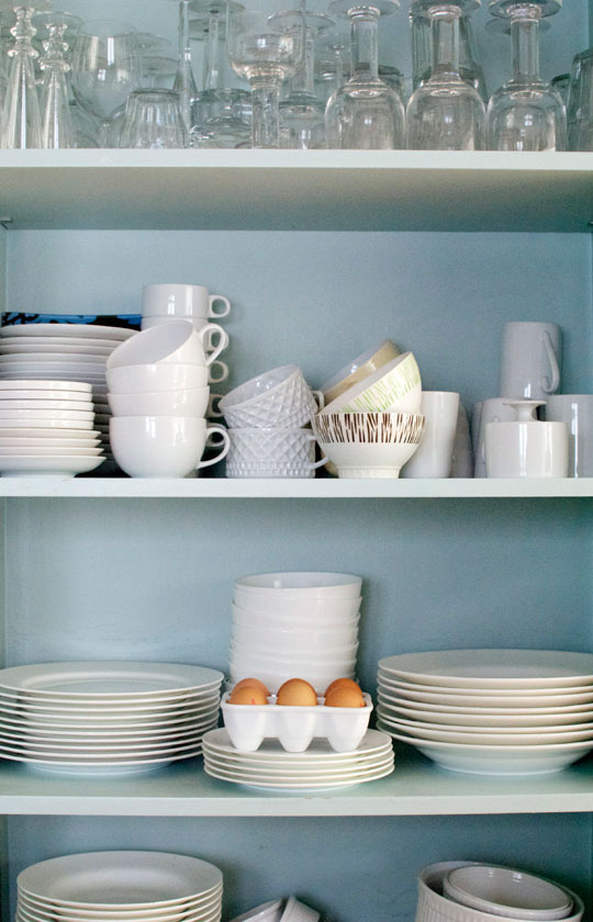 Duck egg blue with white china looks perfect in this London home pantry.  Apartment Therapy