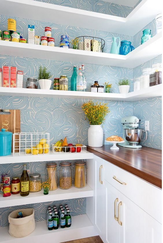 The blue patterned wallpaper from  Farrow & Ball  is very striking in this stylish white pantry.  Denton Developments