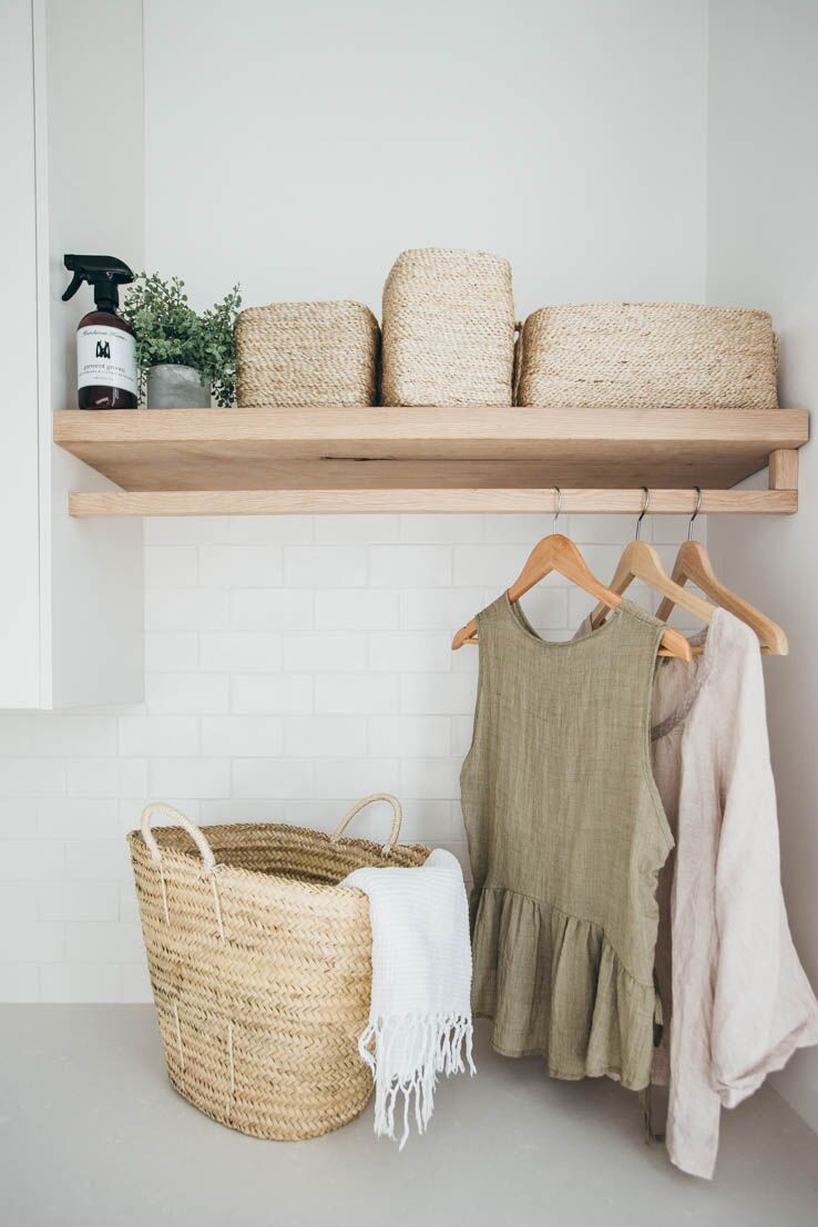 Natural materials looking very inviting in this laundry. Custom timber rod and shelf with woven baskets.    Kyal and Kara