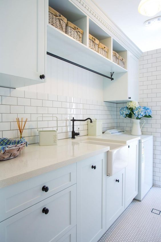 The black hanging rail matches the door knobs and tapware.    Makings of Fine Kitchens & Bathrooms