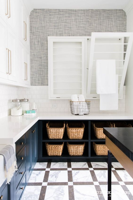 A classy laundry room with everything you'll ever need, including a tilt out drying rack.    Alice Lane Home