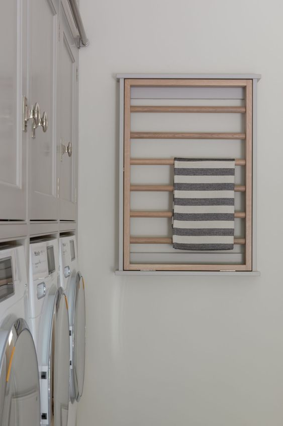 Quality tilt out timber rails on the laundry wall.    Humphrey Munson Kitchens