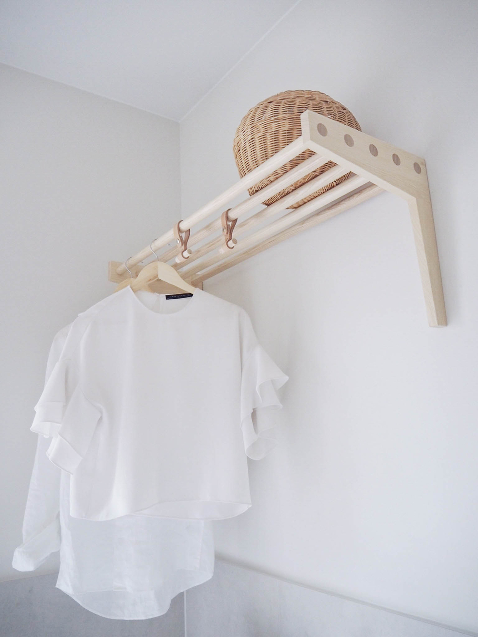 This beautiful Scandinavian  hat rack  is perfect in the laundry for hanging clothes and storing things on top.    Lily