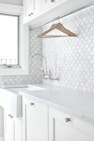 Aren't these scalloped fish scale tiles lovely? A tall hanging space above the bench is an opportunity to feature some impressive tiles.    Provincial Kitchens