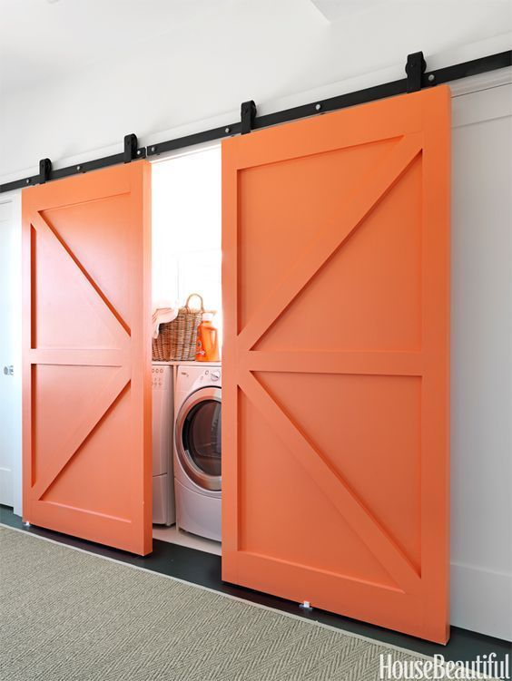 You certainly wouldn't be able to miss these bright orange barn doors. | source:  House Beautiful
