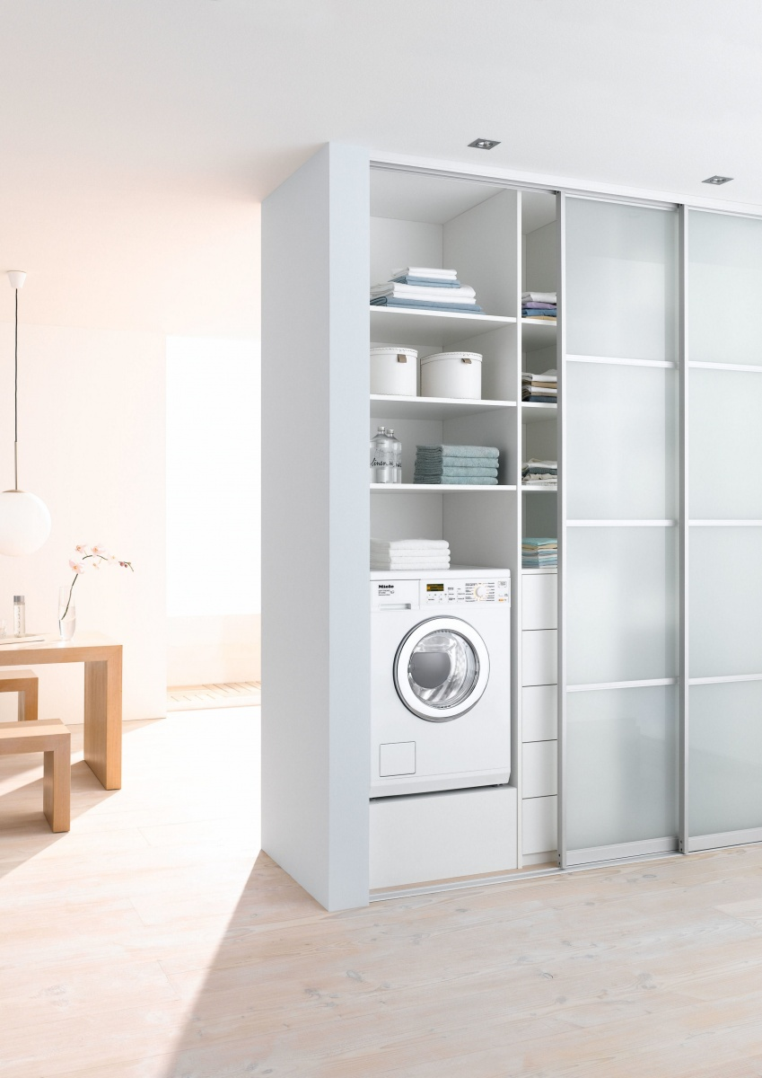 What a space saver! Put your washer-dryer behind sliding doors. | image source:  Miele