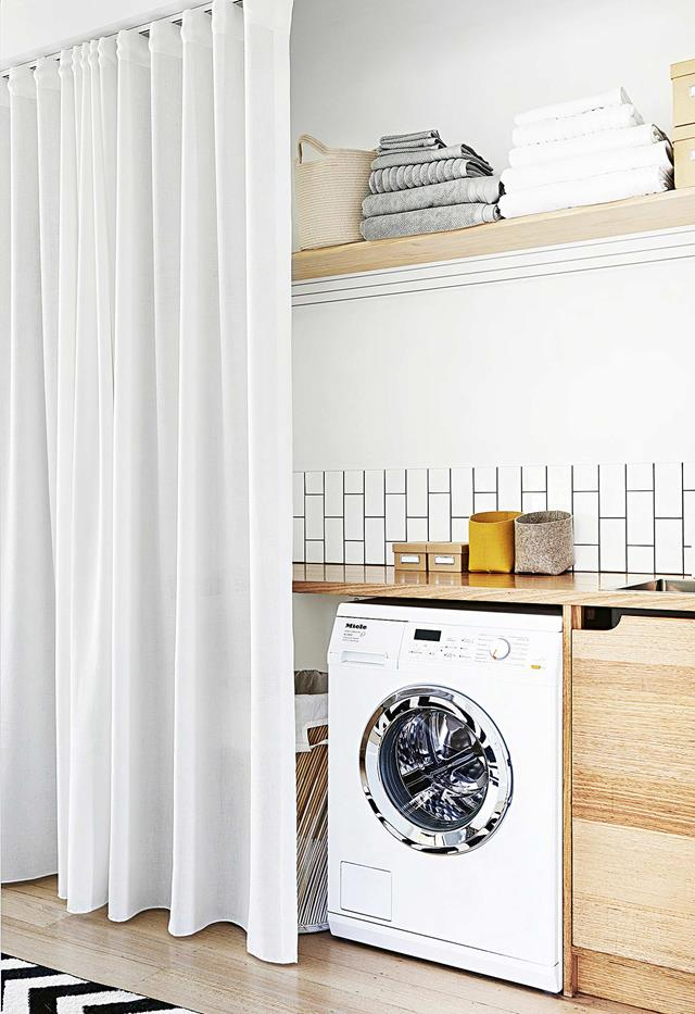 Laundry hidden by a curtain. An old idea made modern again. | interior design:  By Bruno