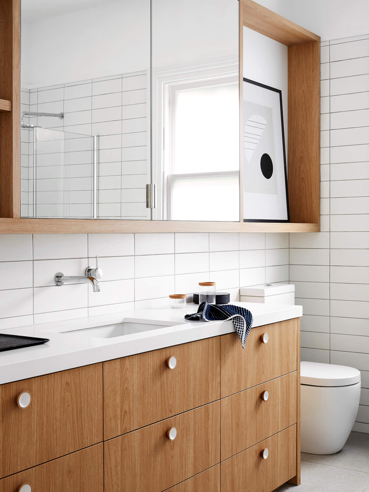 Custom American Oak vanity and face height storage in a Melbourne family home by  Harrison Interiors