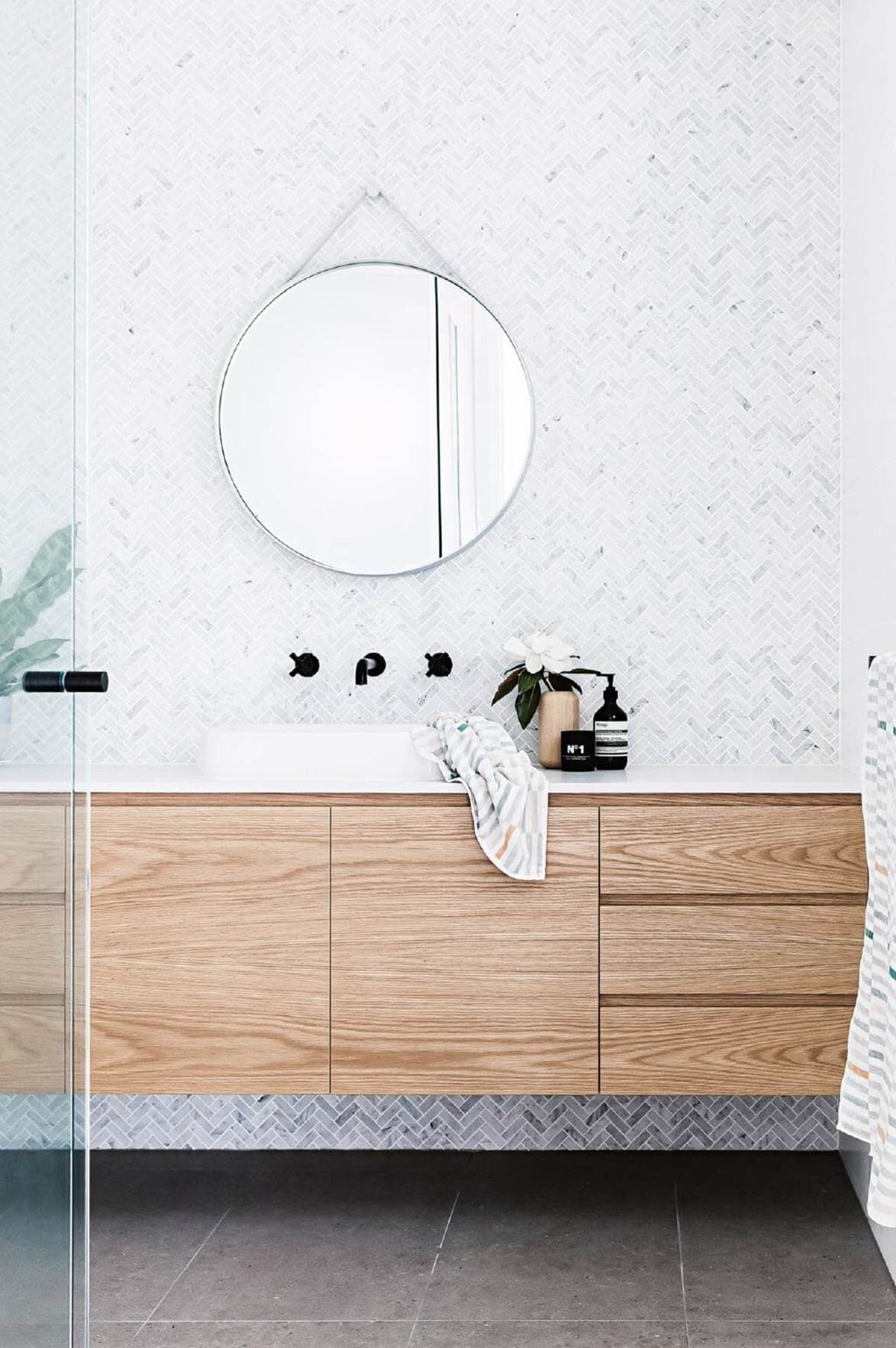 Floating timber vanity with stunning herringbone calacatta marble tiles | architect:  Design Tribe Projects  | tiles:  Surface Gallery  | joinery:  Competitive Joinery  | stylist: Kerrie-Ann Jones | Photographer: Maree Homer