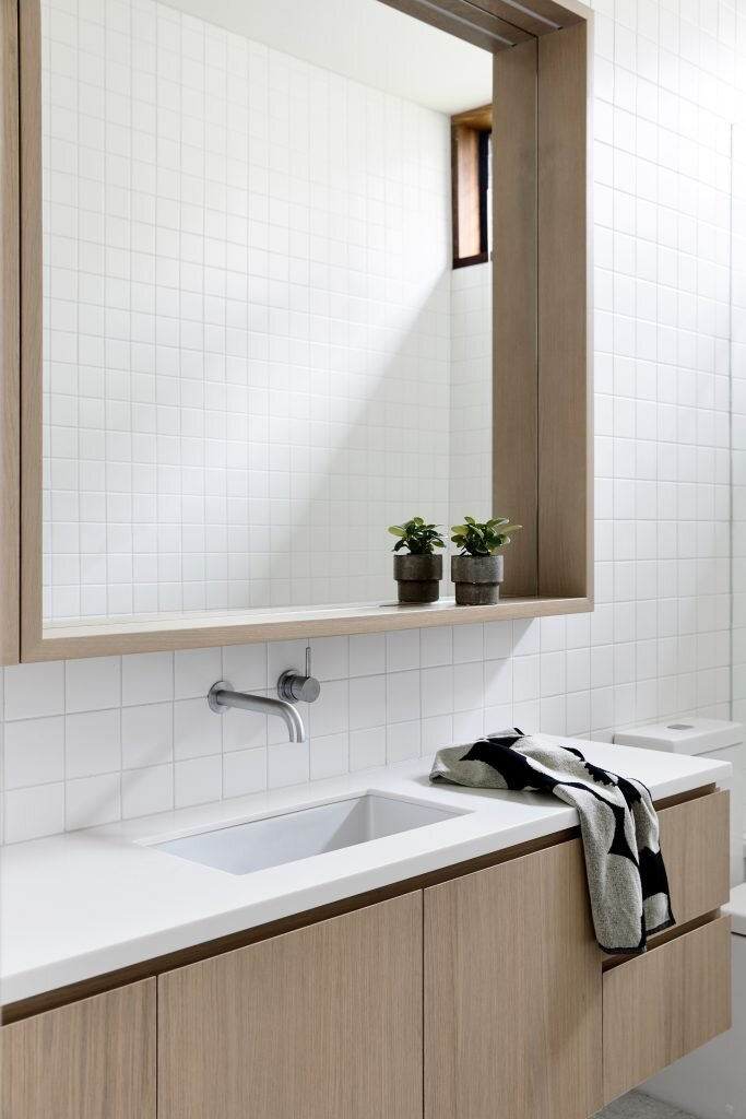 Under mount basin and wall tap with a framed mirror that creates a shelf, genius! | photography: Derek Swalwell | design:  Rob Kennon Architects