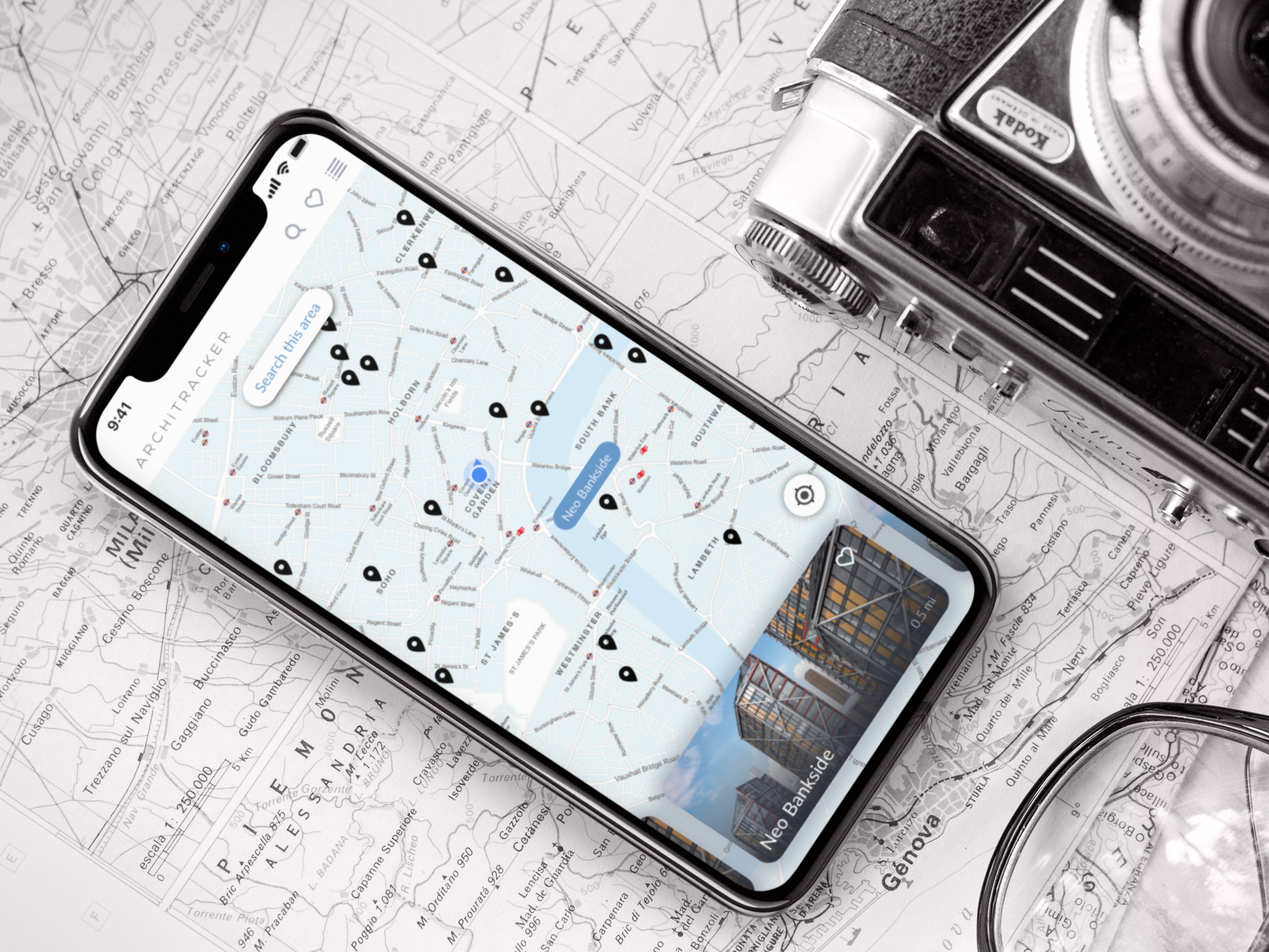 iphone-x-mockup-lying-on-a-map-next-to-a-vintage-camera-a17501.png