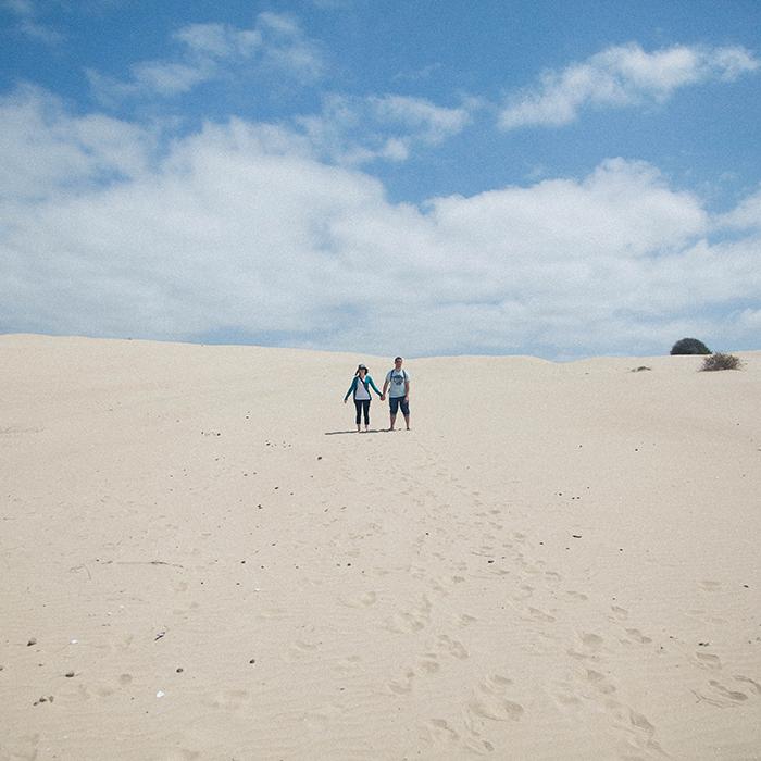 Walking through sand  —Pismo