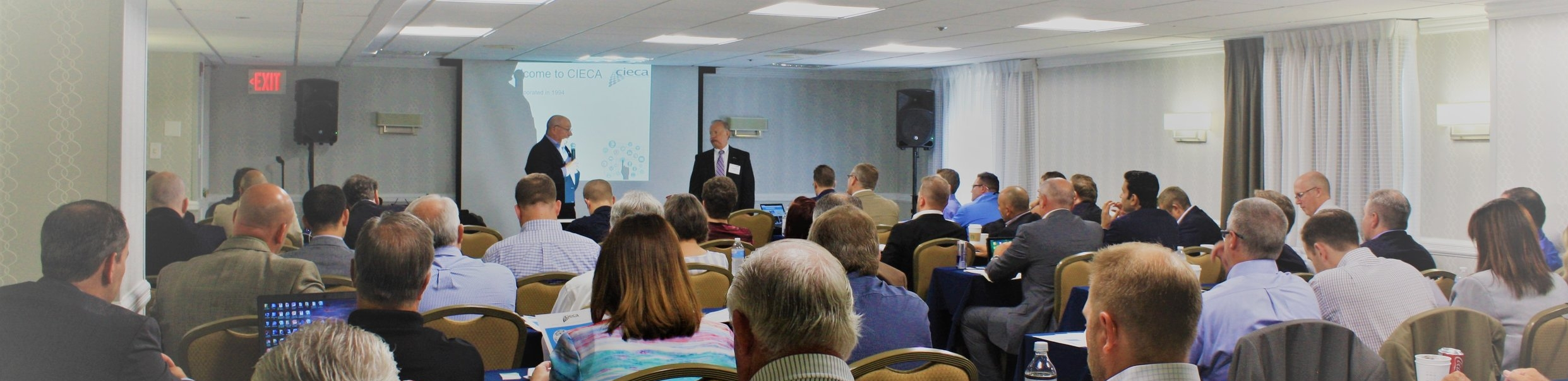 CIECA representatives Charley Quirt and Fred Iantorno present information about data standards to PIRC in July 2018, Chicago, Ill.