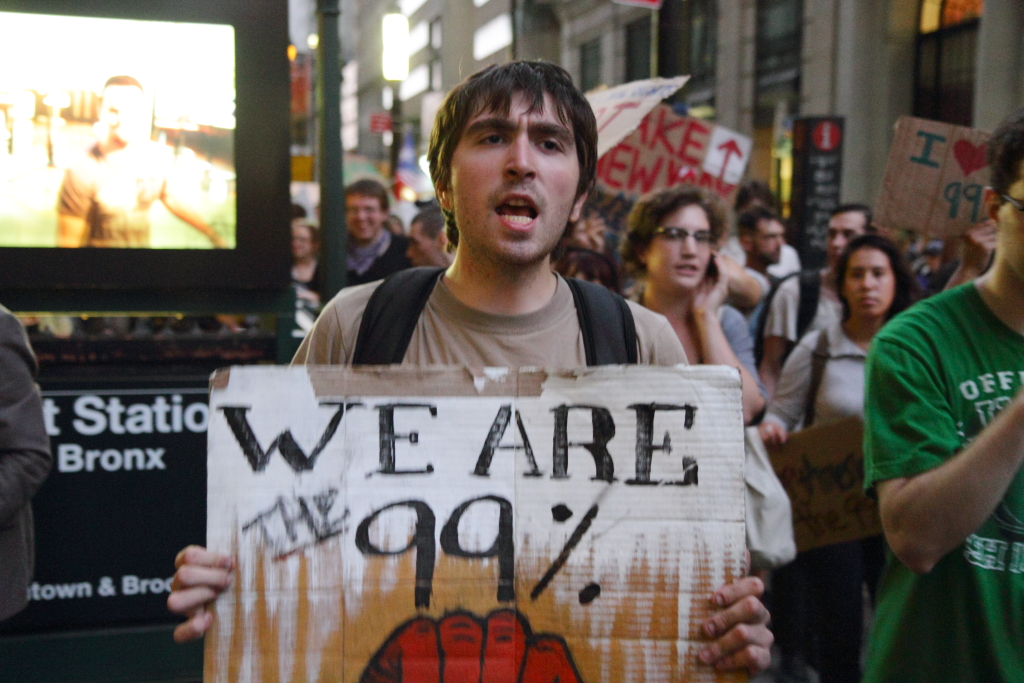 """""""We Are The 99%"""", Paul Stein -  https://www.flickr.com/photos/kapkap/6189131120/  Licensed by Creative Commons -  https://creativecommons.org/licenses/by-sa/2.0/legalcode"""