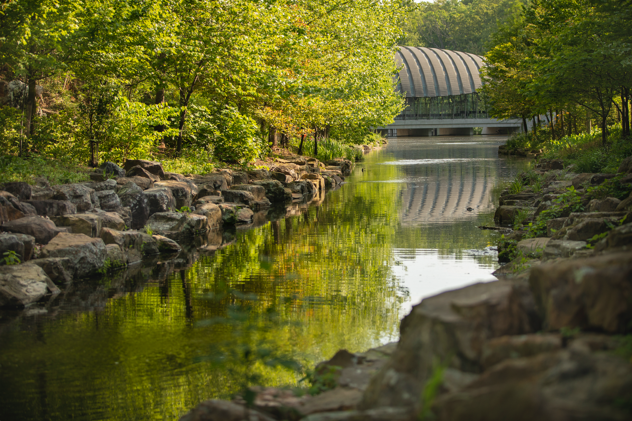 View of Town Branch Creek and south side of Crystal Bridges. Courtesy of Crystal Bridges Museum of American Art, Bentonville, Arkansas.
