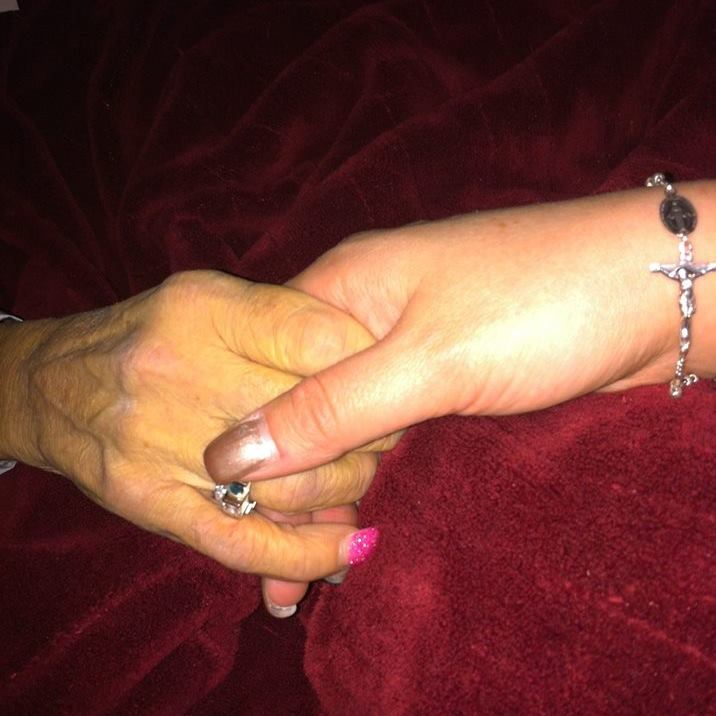 Erin and her mum holding hands