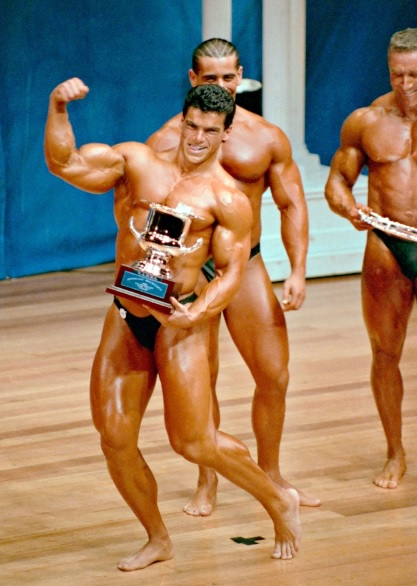 Winning pose with trophy at the 1989 NABBA Mr. Australia