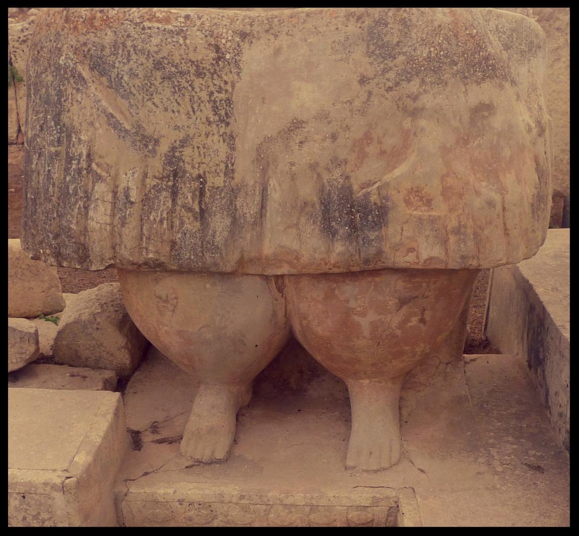 Bottom half of a robust statue at Tarxien