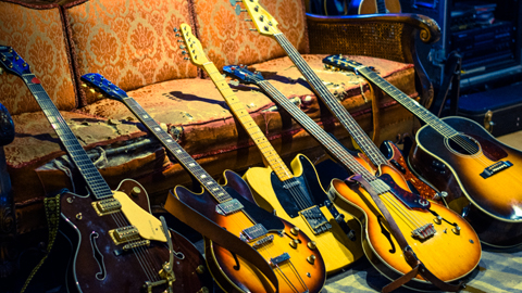 Guitars. From left.... Gretsch Country Classic, Gibson ES-330, Fender '52 Telecaster, Epiphone Rivoli Bass, Fender '64 Precision Bass, Gibson J-45 Custom. Dan uses drumsticks made of wood.