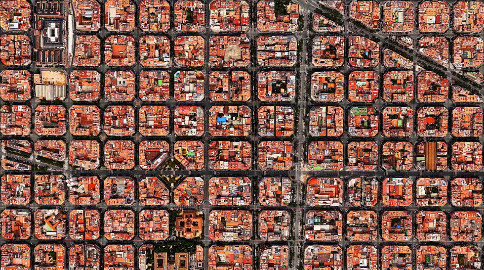 4. SMALL BLOCKS   Blocks should be less than or equal to 2 hectares and 70% of the blocks should comply with this   standard. Exceptions made for industrial areas. Small blocks scale the city down to human size so that walking is more pleasant. Traffic is more efficient in the dense road mesh created by small block development. The urban landscape of Barcelona is dominated by small blocks which makes for a pleasant walking experience for pedestrians.