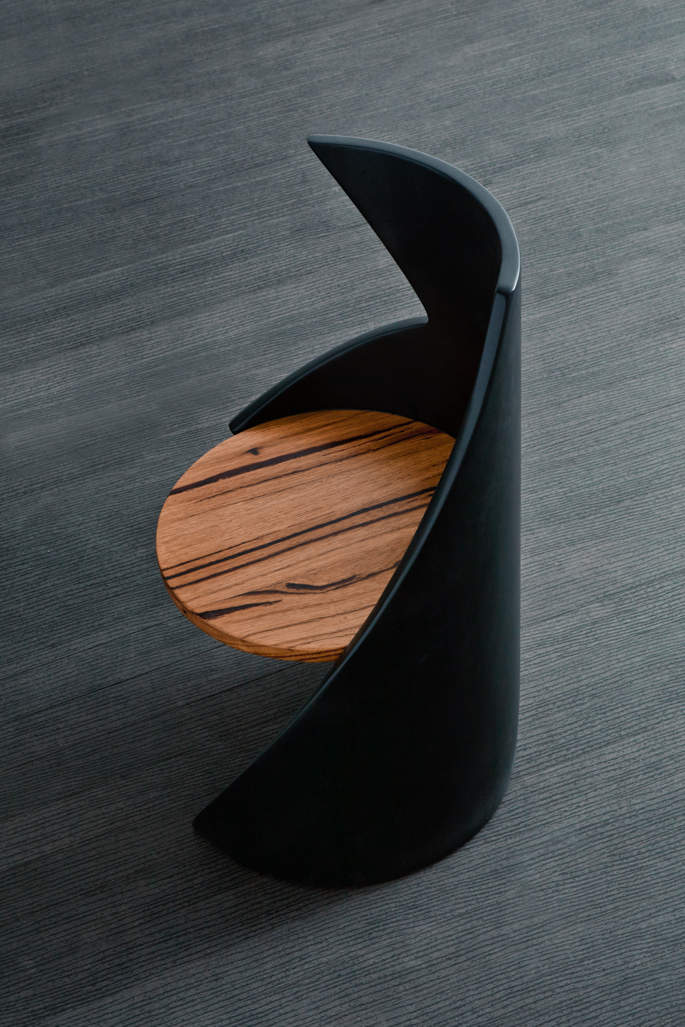 The house - inspired by exciting forms in architecture and recreating that in this shapely chair changing its appearance depending what angle you catch it at. using the same techniques as mr potato head 2.0 to get the gentle soft curves, this is one seriously funky chair