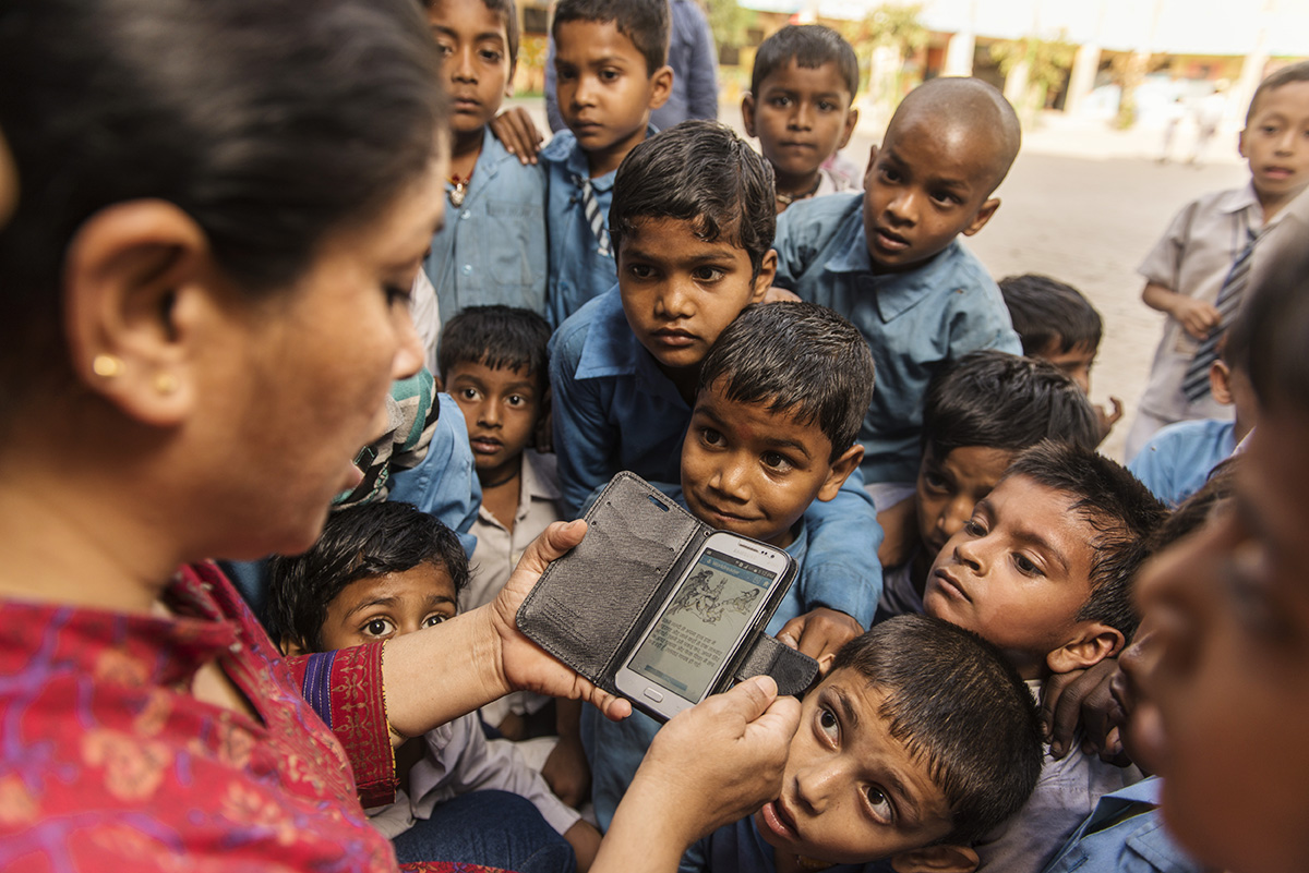 Children listening to a story.  Credit: Worldreader