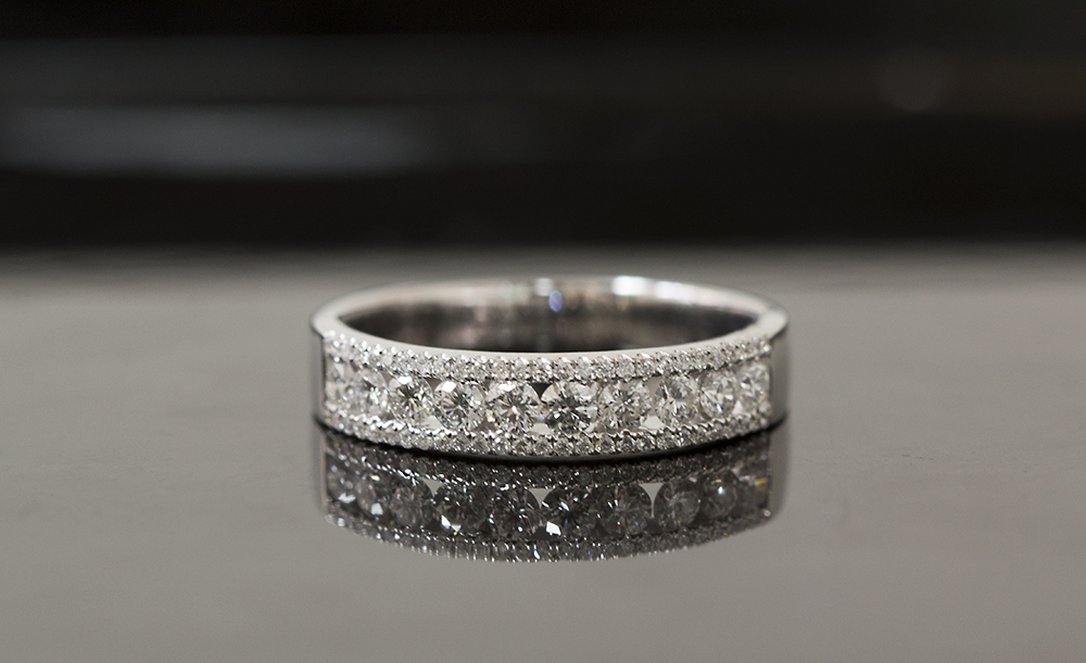 Puzzle ring channel set dress ring with micropave round brilliant cut diamonds.jpg