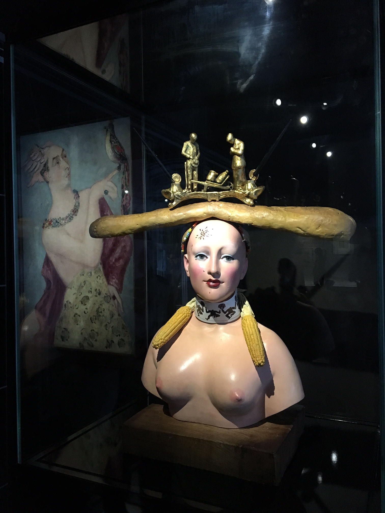Christian Dior's surrealistic hats were perhaps inspired by his friend Salvador Dali's sculptures like Retrospective Bust of a Woman featuring an inkwell and a baguette balancing on her head.