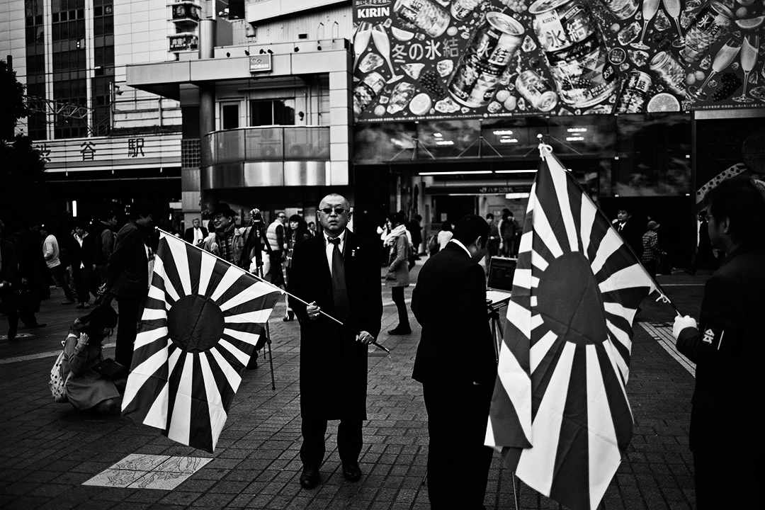 Uyoku Dantai  nationalist in front of Shibuya station promote their nationalist doctrine as they show the sun raising flag