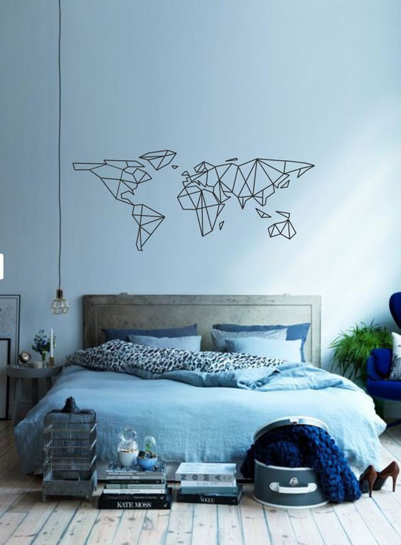This graphical map works well here. The wall colour and soft furnishings use similar and complimentary shades of blue. This, together with the elements of grey in the room, soften the black of the map. The black flex of the lightbulb and black/white print on the duvet help bring everything together.